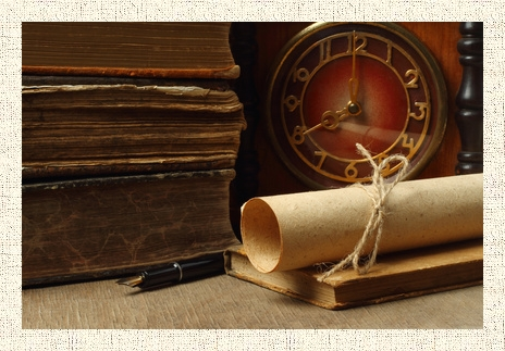 Retro composition with books, clock, paper and pen on wooden background
